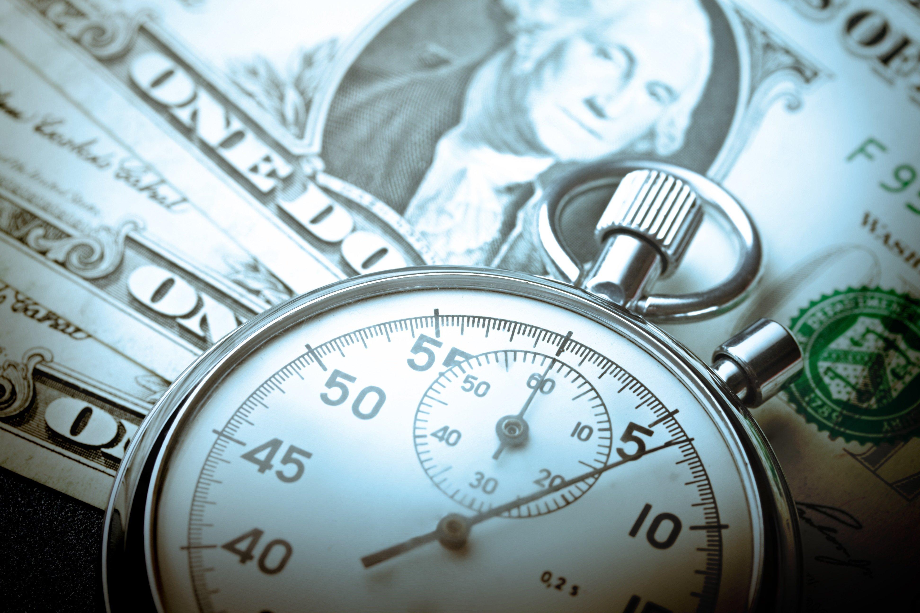 stopwatch on top of money
